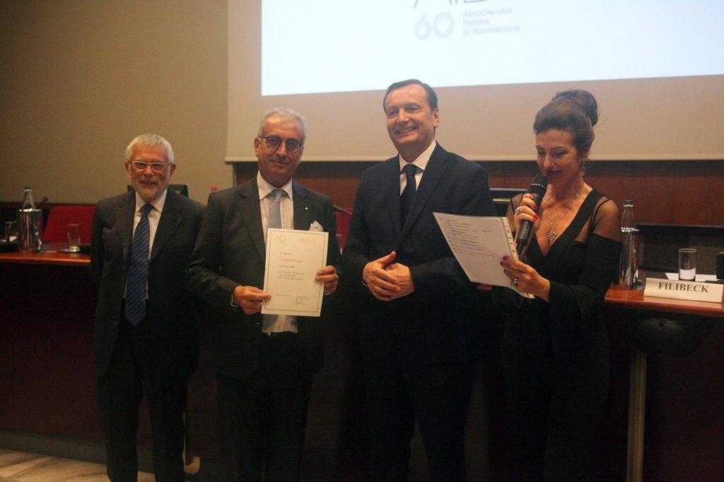 Dante Cariboni riceve il premio per il socio storico Cariboni Group, ph. Giulio Crosara